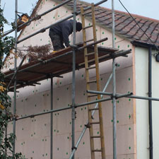 External wall Insulation fixed to a gable wall and extending the tiled verge to allow for new Insulation
