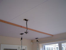 Thermal boards applied to a ceiling