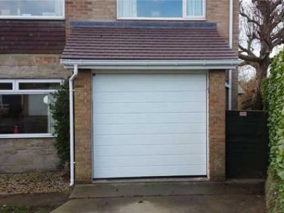 completed tiled roof with PVCu fascia boards and an insulated garage door - harrogate