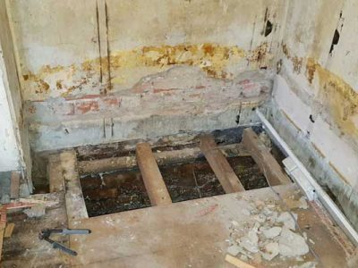 damp walls and rotten floor