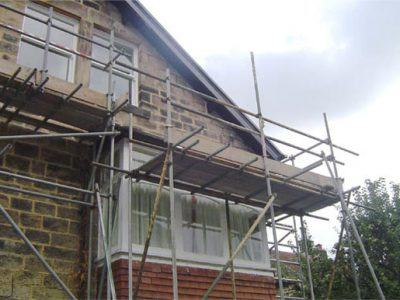 high level roof timbers and old sash windows renovated and painted harrogate house