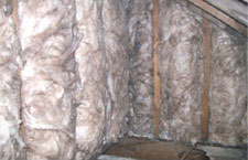 Insulation behind vertical studwork