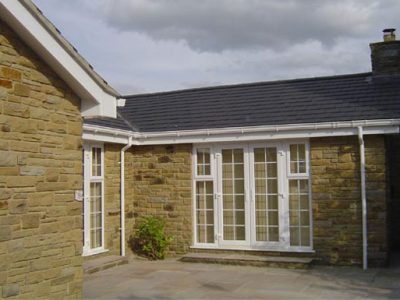 new roofline system including deep flow guttering new A rated windows and doors leeds property